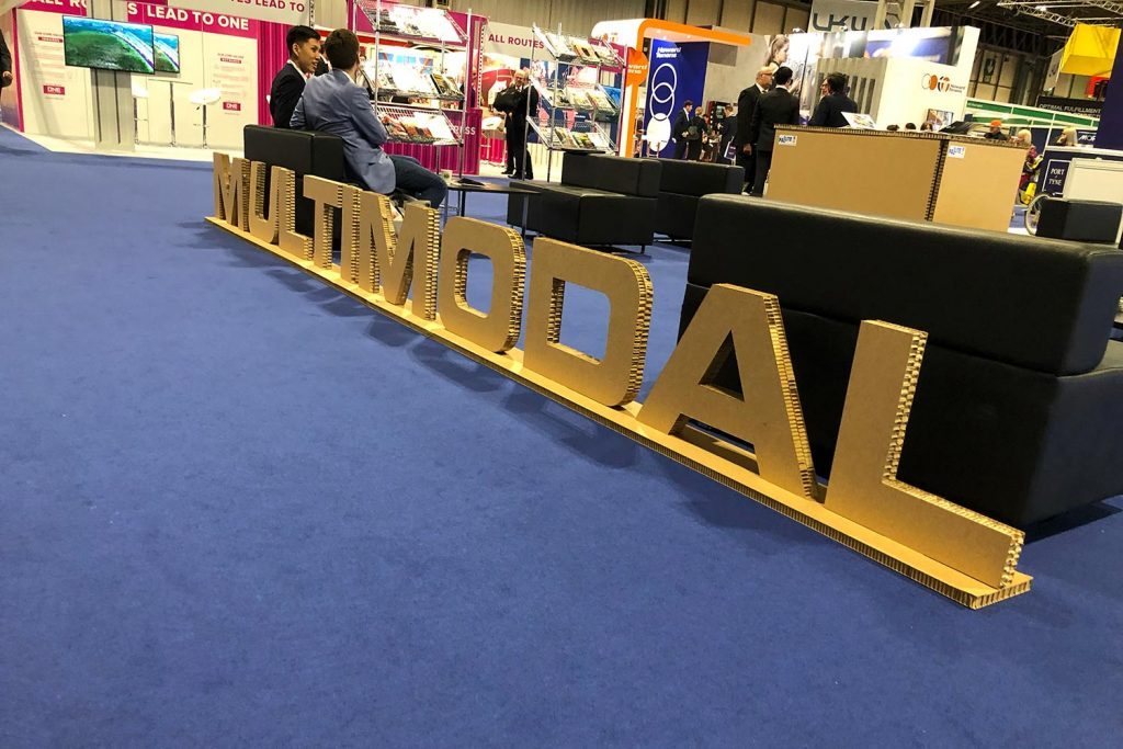A large Multimodal logo made from cardboard