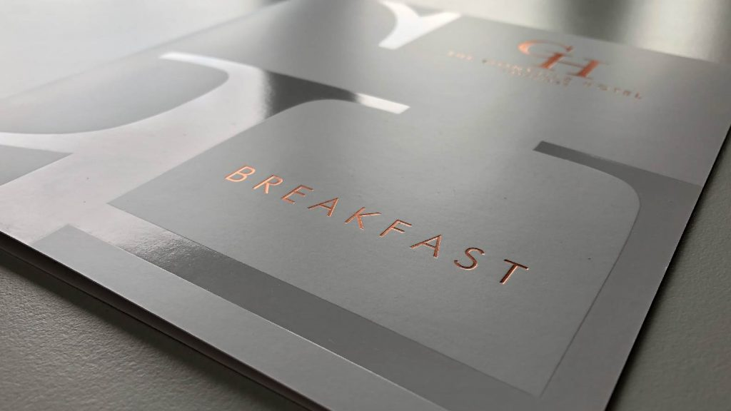 Copper foiled breakfast menu designed by BAAM for Gonville Hotel